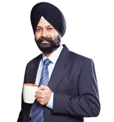 Portrait of a sikh businessman drinking coffee and smiling